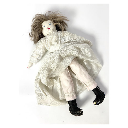 Vintage hand made 1950s creepy rag doll  in a lace dress and pantaloons.