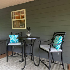 Two bistro tables for outdoor dining