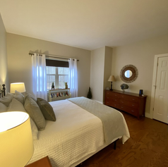 Downstairs guest room with queen bed
