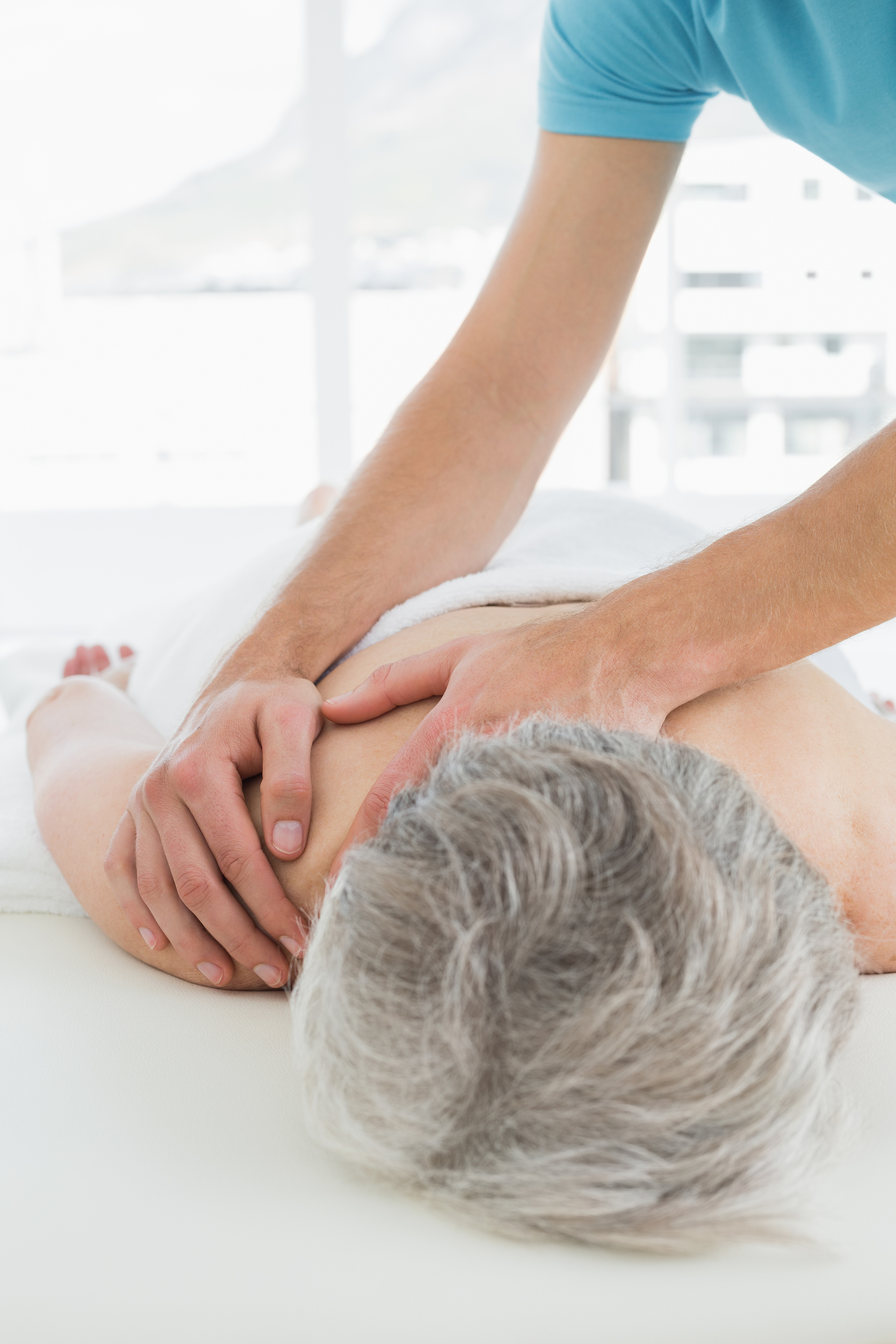 Close-up of a physiotherapist massaging