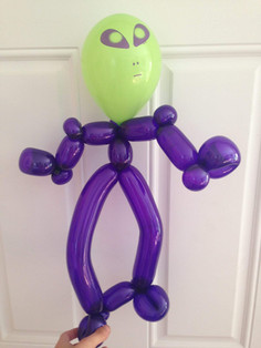 Boy's birthday party alien balloon twisting