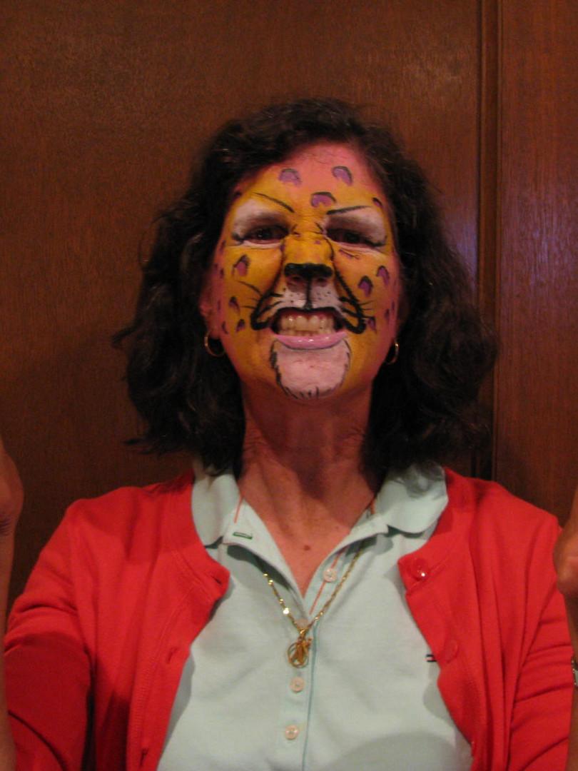 Cheetah face paint, wild safari themed birthday, fun for the whole family
