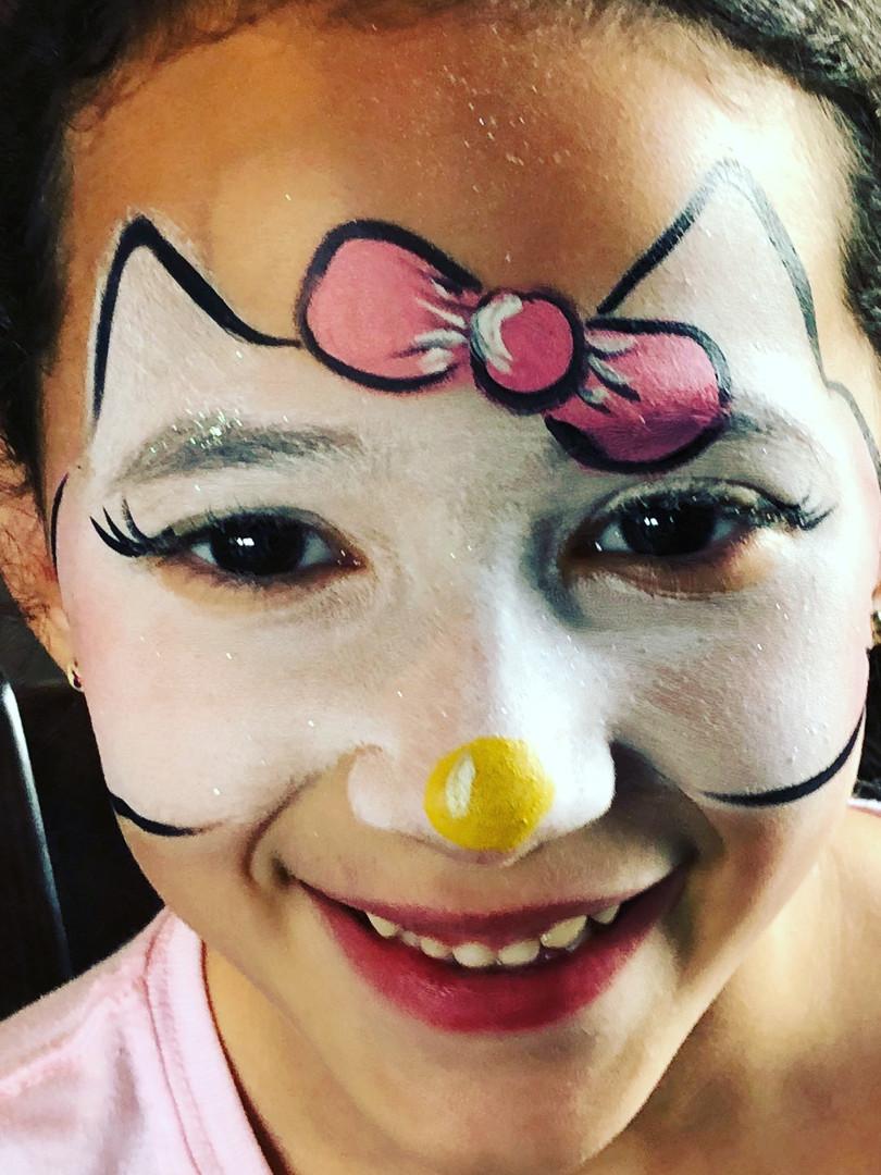 Sweet girl's birthday party face paint in FarragutTN