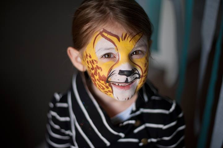 Cheetah face paint and lots of glitter, kid's party, children's birthday party Knoxville TN