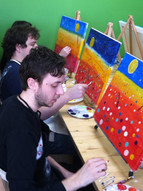 Friends painting at a paint and sip party