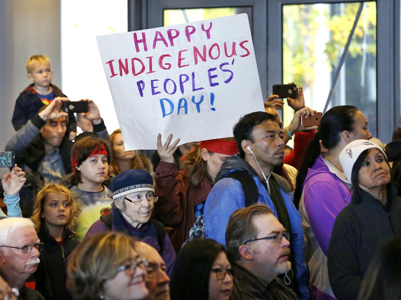 People look on at a celebration of Indigenous Peoples' Day in 2016 at Seattle's City Hall.