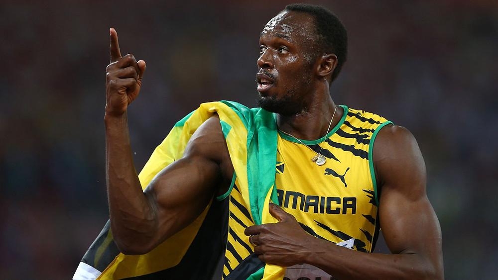 Usain Bolt With the Jamaican Flag