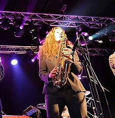 Marie-Claire on stage playing saxophone.