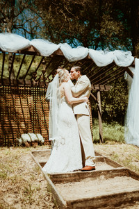 bride and groom kissing after saying vows