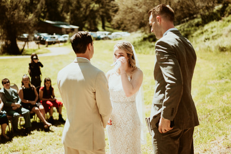 bride whipping tears during vows