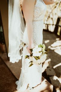 bride holding flowers by her side