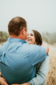 engaged couple hugging and smiling at each other at the alisal guest ranch and resort