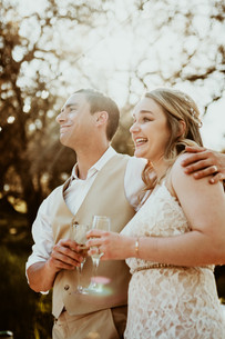 bride and groom smiling and laughing during friends speech