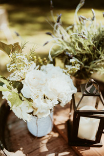 floral designs of ceremony grounds with a lamp and rustic barrel