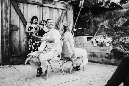 bride and groom play the boot game at wedding reception