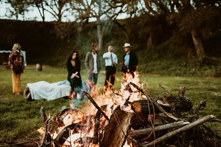 family overlooking bonfire after wedding reception