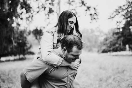engaged couple giving piggy back ride on the alisal guest ranch and resort