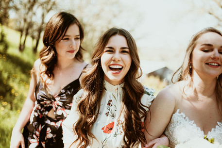 bridal party laughing with eachother