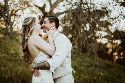 bride and groom portrait at sunset under oak trees at springtime