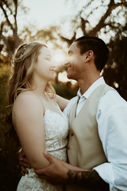 bride and groom looking into each others eyes at sunset in California