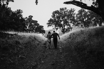engaged couple walking and holding hands at the alisal guest ranch and resort
