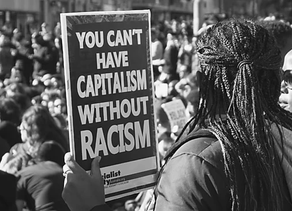 Coronavirus has exposed the undeniable link between racism and capitalism. Now it's time for change!