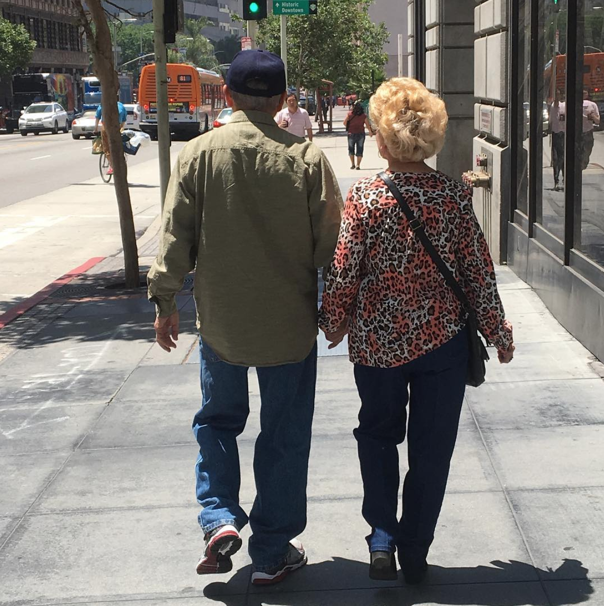 Walking hand in hand in Downtown LA