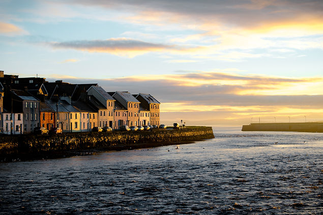 Houses in Galway Ireland along the waterfront at sunrise