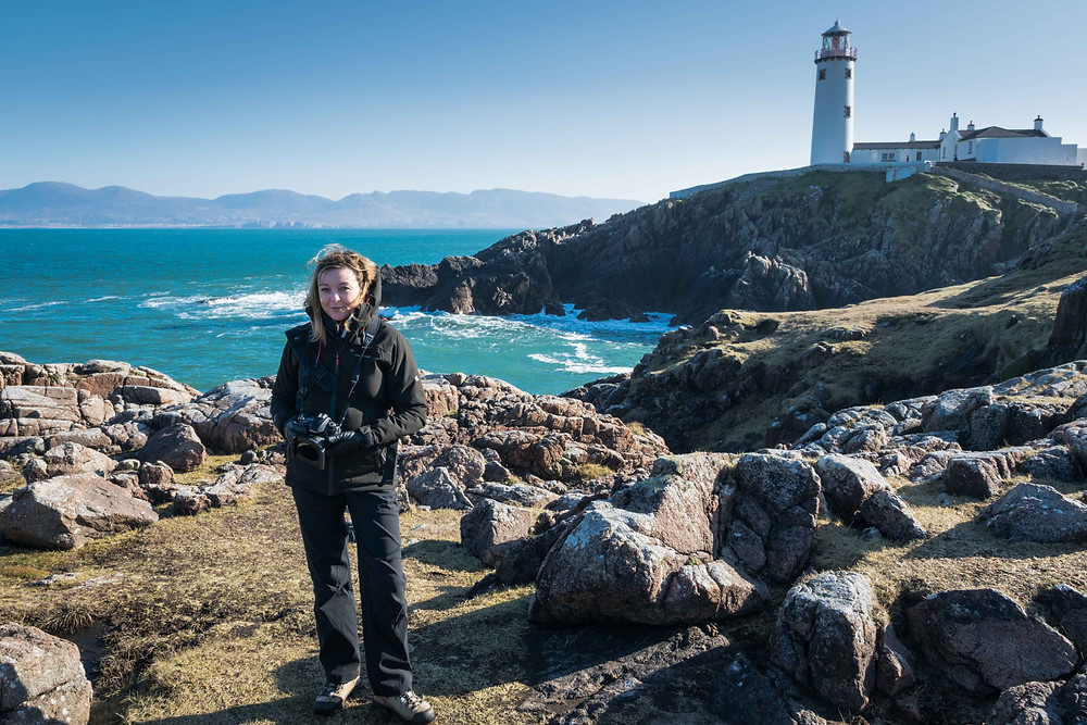 Sharon at Fanad Light house taking landscape photographs