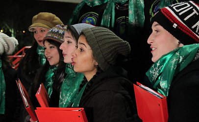 Local community choirs sing carol at the tree lot