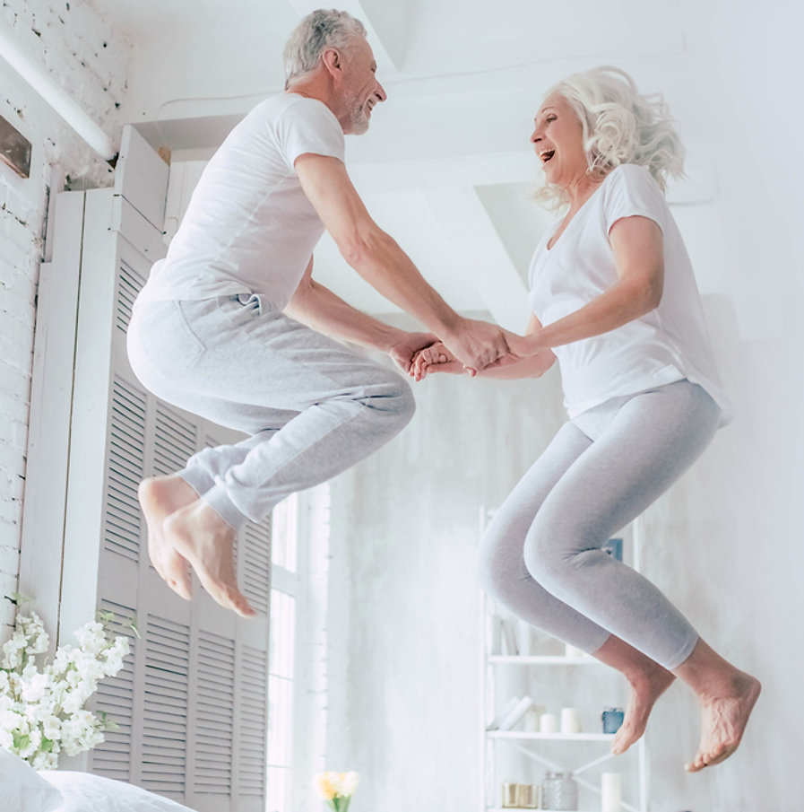 couple jumping in bed