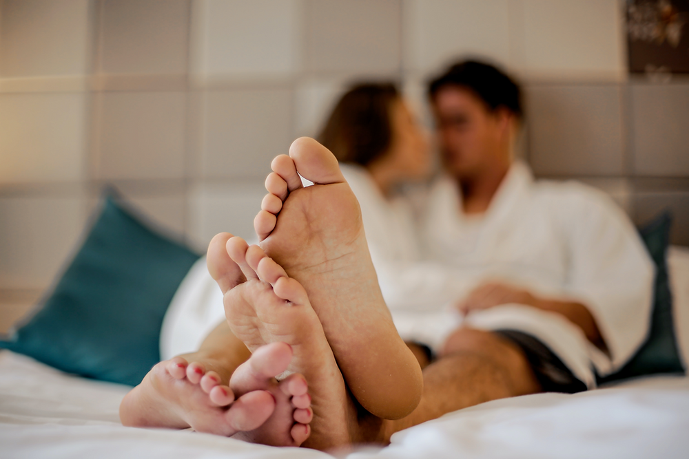 Couple in bed talking to improve intimacy and connection