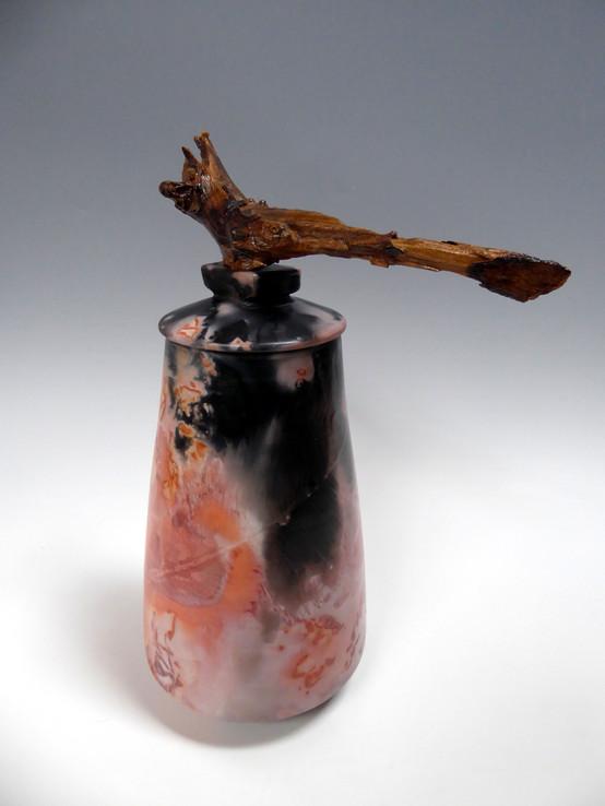 Vessel with African hardwood handle on lid