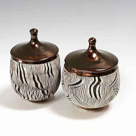 Two lidded jars with copper glazed lids