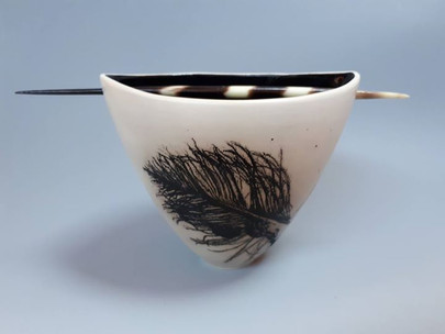 Bowl, pierced with a quill