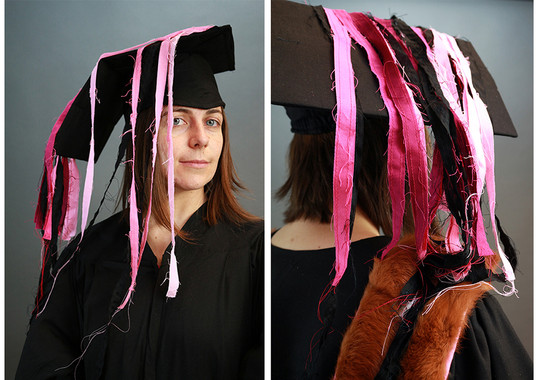 The mortar board or 'academic square cap' is traditionally worn by Bachelor and Master degree recipients. THE REGALIA PROJECT features a cascading mortar board adorned by long, free-flowing, pink and black tassels. This cap is designed to be both celebratory and unruly--two emotions I experience in my entanglement with the academy.