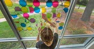 Allie Kerkhoff installing artwork.