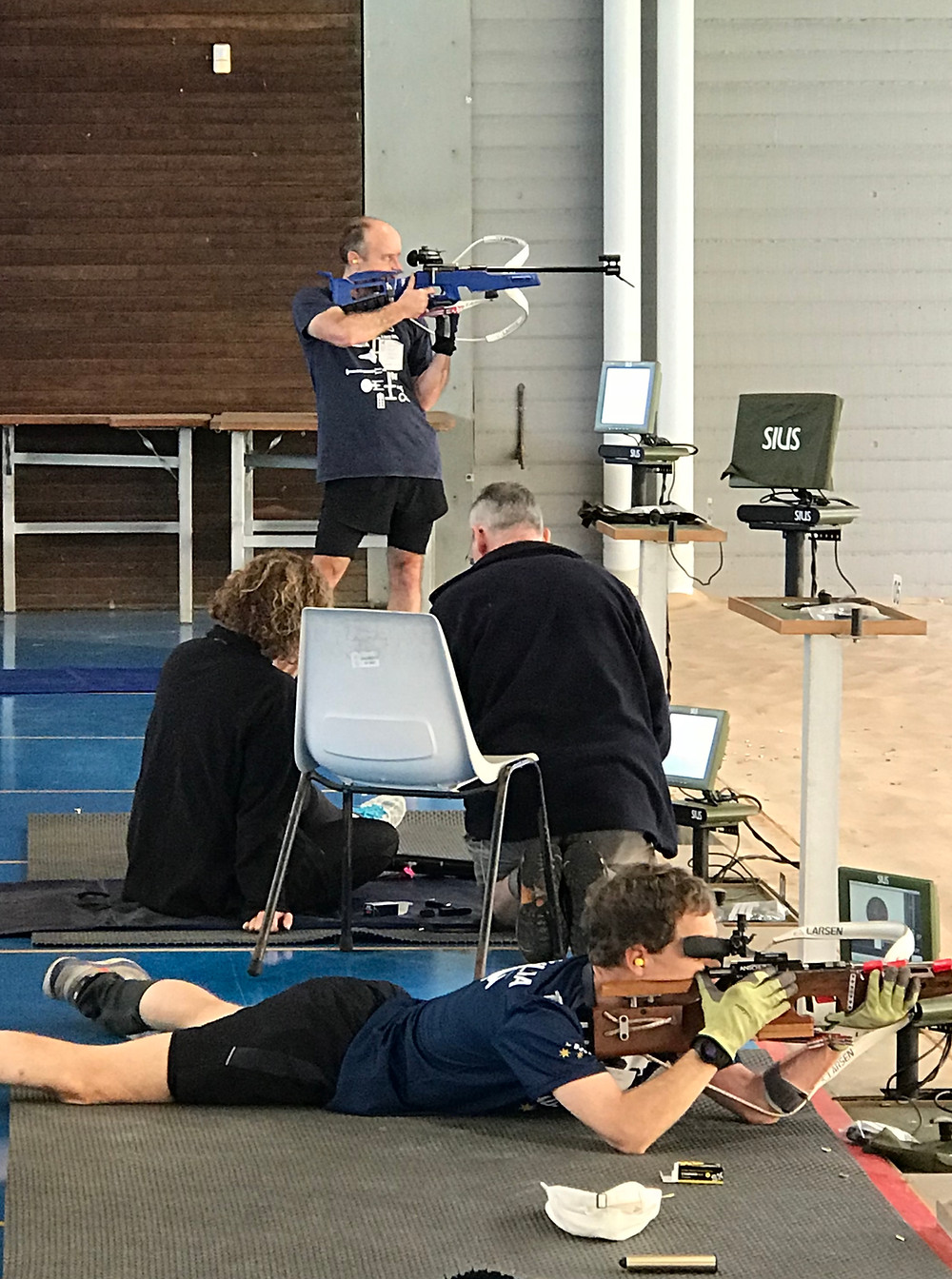 Practising shooting from a standing position (background). Prone position (foreground)