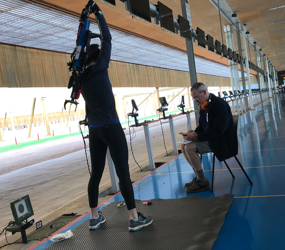 Part of biathlon is getting your rifle off and on your back quickly and safely.