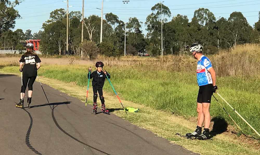 Performing drills on our rollerskis.