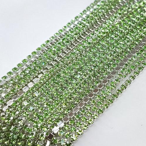 Стразовая цепь ~ Светло-зелёная в серебре 1,4мм (10см)