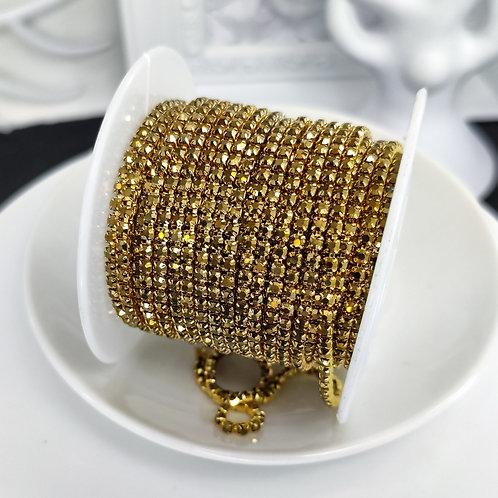 Стразовая цепь ~ Золото темное  металлик в оправе в тон 2мм (10см)