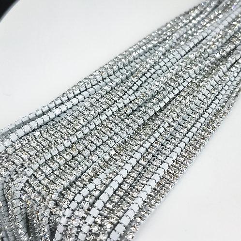 Стразовая цепь ~ Прозрачная в белой оправе 1,4мм (10см)