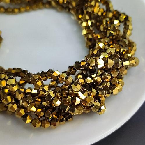 Биконусы тёмное золото 3мм (125шт)