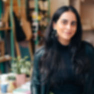 happy-entrepreneur-standing-in-her-store