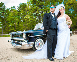 Bride and groom on a classic car