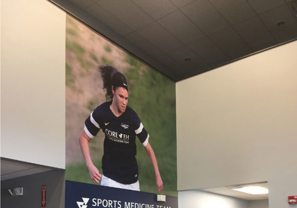 Matte graphics for entryway in Seacoast United Sports Complex's Epping facility.