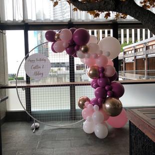 Backdrop, Signage & Shades of Pink Balloons