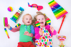 Child with music instruments. Musical education for kids. Colorful wooden art toys for kids. Little