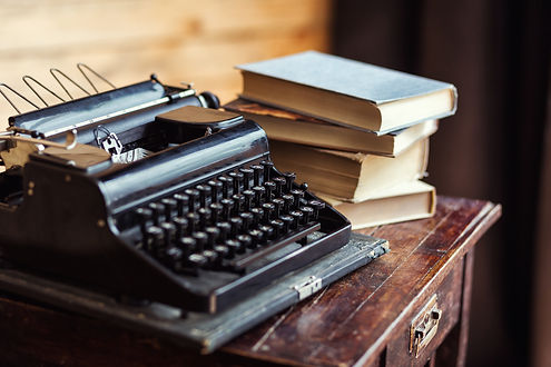 vintage typewriter and books on the tabl